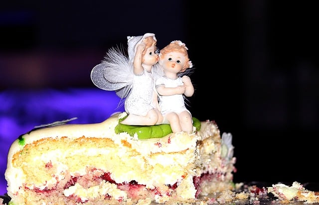 A piece of cake sitting on top of a stuffed animal